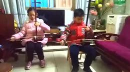 信阳市王鹏器乐培训中心王浩宇,张心宜学奏《战马奔腾》
