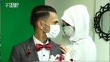 为防新冠病毒 加沙情侣戴口罩结婚