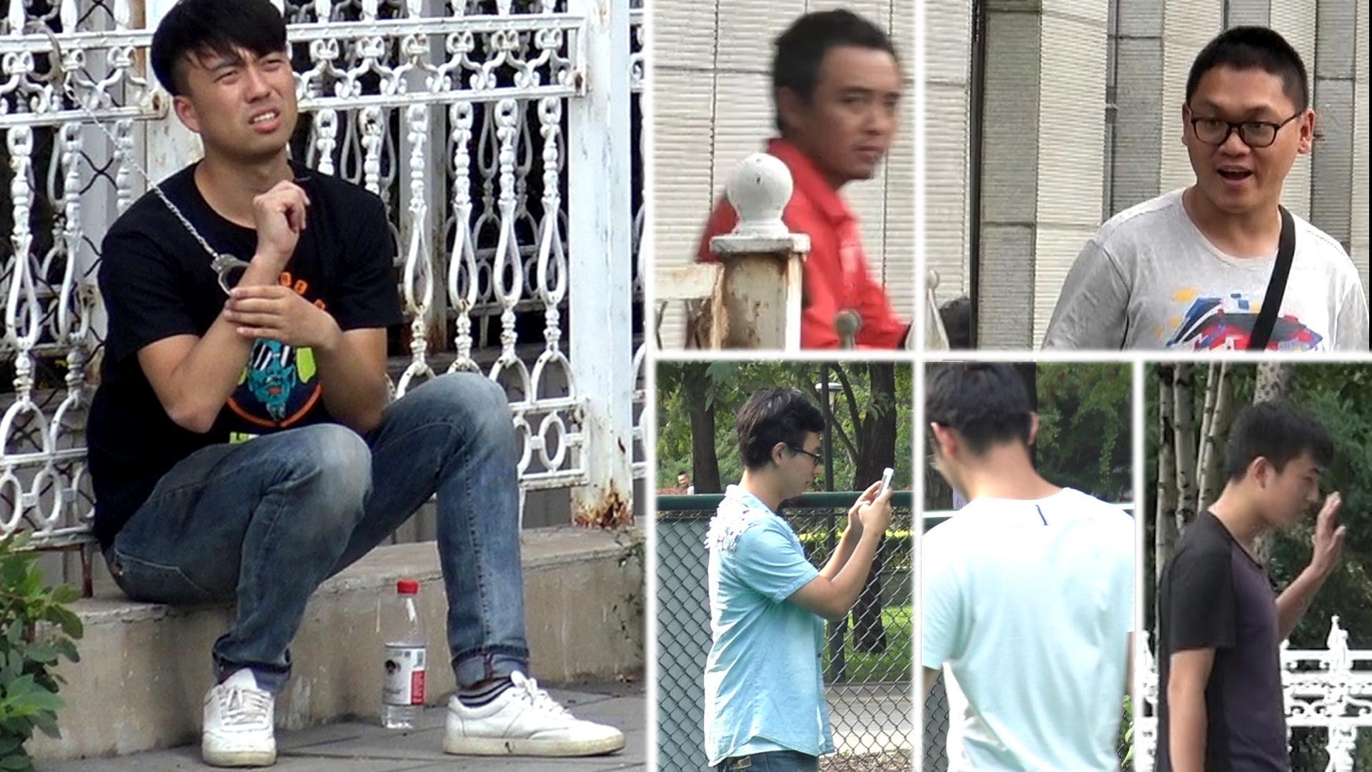 一男子被拷在铁网上,竟没有一个人想救!
